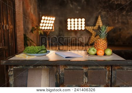 Loft Minimalistic Kitchen Interior Photo With Retro Design Fridge And Fruits On Rustic Wooden Table.