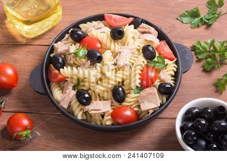 Pasta Salad With Tuna , Tomatoes And Olives In Pan