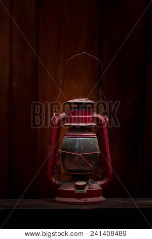 Vintage Oil Lamp On Wooden Table