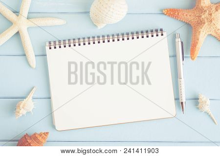 A Blank Note With Starfish And Sea Shells On A Blue Wooden Floor,summer Concept