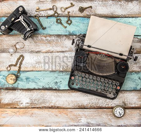 Antique Typewriter And Vintage Accessories On Wooden Background. Flat Lay Still Life