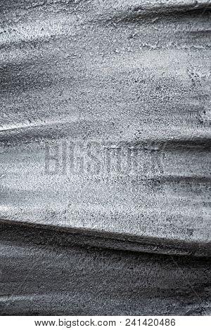 Horizontal Wave Lines On A Dapple Metallic Surface