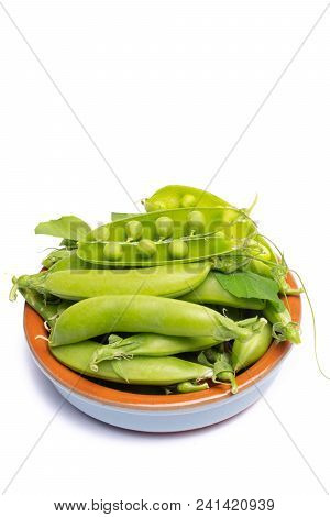Fresh Green Ripe Sugar Snaps, Sweet Peas In Bowl Copy Space Close Up Isolated On White Background