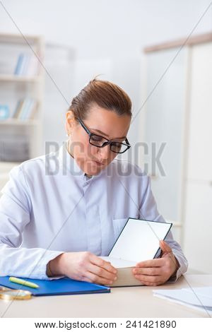 Woman doctor reading book