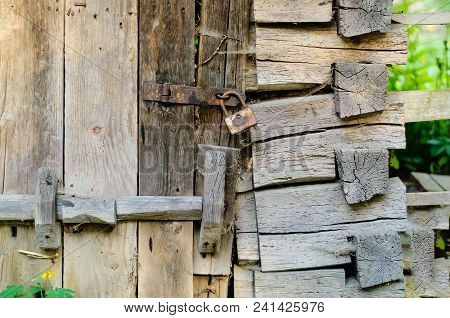Authentic Wooden Door And A Vintage Lock On A Rusty Loop, Copy Space, Concept Of Old Objects