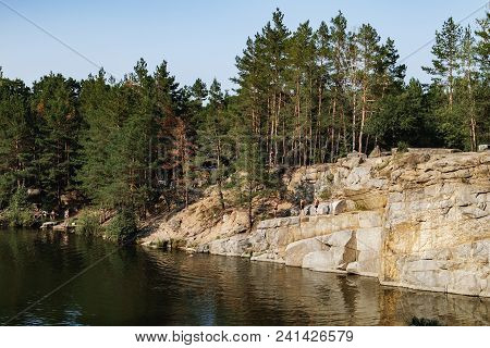 Korostyshiv, Ukraine - August 15, 2017: People Have Rest And Swim On The Lake In The Middle Of A Con