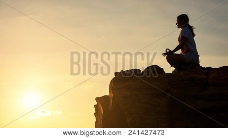 Silhouette Beautiful Asian Woman Perform Lotus Yoga Meditation Pose On Top Of Hill During Sunset Wit