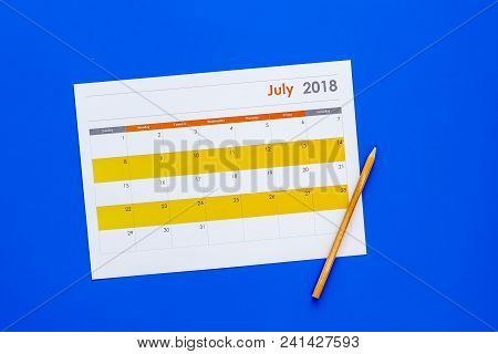 Planning. Point The Date In Calendar By Pencil. Set The Goal. Choose Date. Calendar On Blue Backgrou