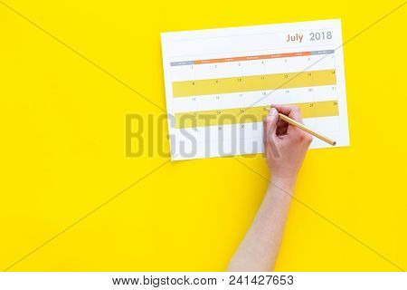 Planning. Point The Date In Calendar By Pencil. Set The Goal. Choose Date. Calendar On Yellow Backgr