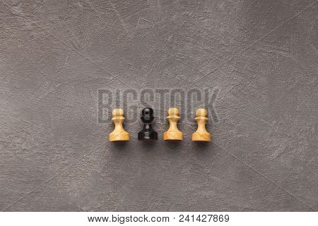 Line Of White Pawns With One Black Inside, Top View. Uniqueness Of Individuals In Mass, Loneliness C