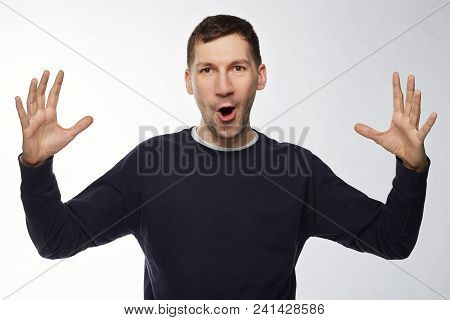 Happy Surprised Young American Male Wearing Dark Blue Jacket  Gesturing With Hands As If Showing Siz