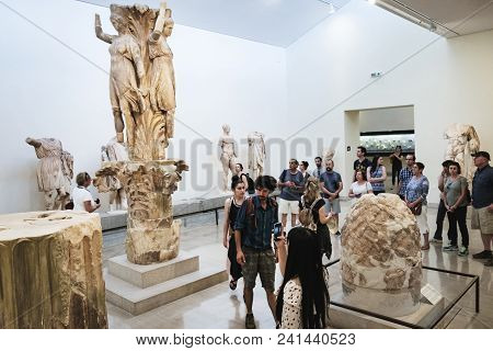 Delphi, Greece - September 21, 2017: Tourist Visiting Archaeological Museum In Delphi Greece