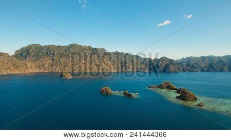 Aerial View: Beach, Tropical Island, Sea Bay And Lagoon, Mountains With Rainforest, Palawan. Lagoon