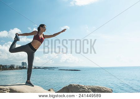 Full Length Side View Beaming Girl Stretching Body On Open Air Near Ocean. Glad Athlete Concept