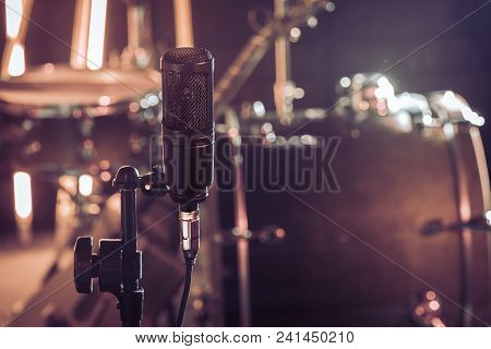 The Microphone In A Recording Studio Or A Concert Hall Close Up Of Drum Kit And An Acoustic Guitar I