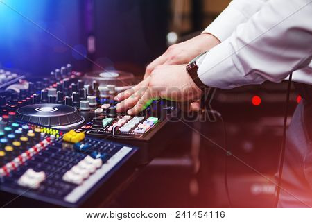 Closeup Hands Of Dj At The Professional Console Wearing White Shirt. Disc Jockey Playing On The Best