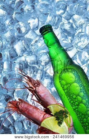Bottle Of Beer With Royal Shrimp Ice Cubes.closeup.green Bottle.hot Summer Fresh Drink.copy Space
