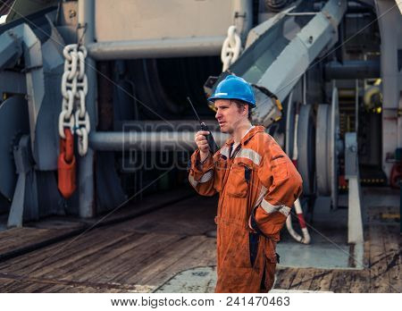 Marine Deck Officer Or Chief Mate On Deck Of Marine Vessel Or Ship , Wearing Ppe Personal Protective