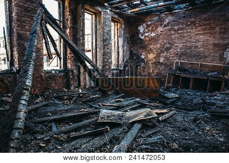 Ruins Of Burned Brick House After Fire Disaster Accident. Heaps Of Ash And Arson, Burnt Furniture, C