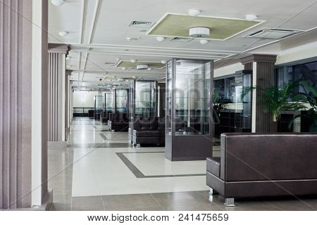 MOSCOW, RUSSIA - DEC 15, 2017: Interior of spacious lobby with leather sofas and green plants in Moscow youth center KVN Planet - convenient multimedia concert hall with a capacity of 800 seats.