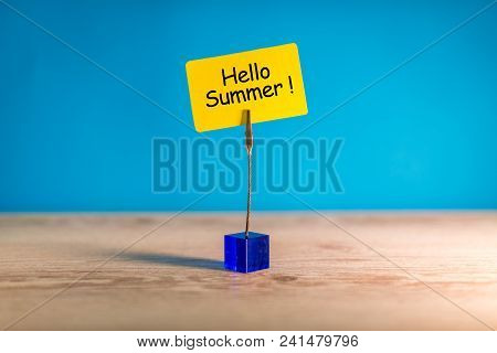Hello Summer - Text On A Little Yellow Tag On Blue Bright Background. First Summer Day. Happy Childr