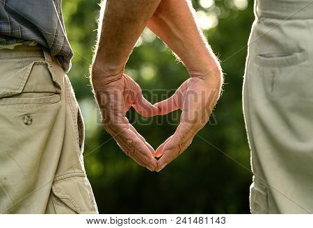 A Heart In My Hands: Men Showing Love With Hand Signs
