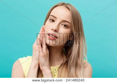 Beautiful Young Woman With Clean Perfect Skin. Portrait Of Beauty Model Touching Her Face. Spa, Skin