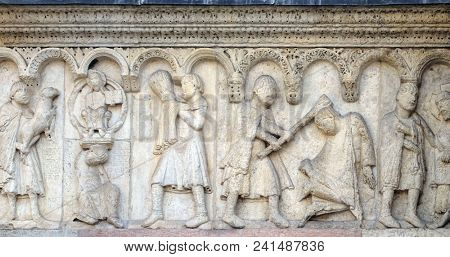 MODENA, ITALY - JUNE 04, 2017: Stories from Genesis: Story about Abel and Cain, The sacrifice of Cain and Abel, Cain kills Abel, God the Father reproaches Cain, relief by Wiligelmo, Modena Cathedral.