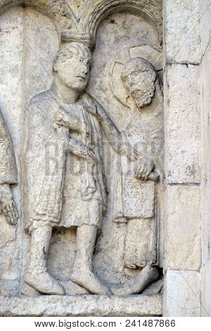 MODENA, ITALY - JUNE 04: Plate with stories from Genesis: Story about Abel and Cain, God the Father reproaches Cain, relief by Wiligelmo, Modena Cathedral, Italy on June 04, 2017.