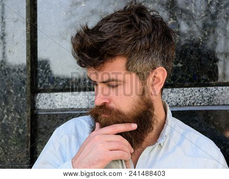Man With Beard And Mustache On Thoughtful, Pensive Face, Black Marble Background. Masculinity Concep