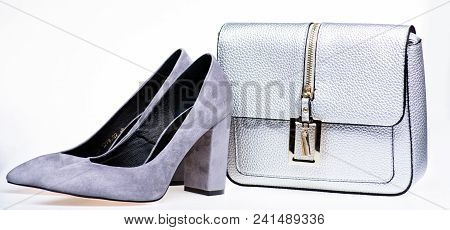 Perfect Match Concept. Pair Of Fashionable High Heeled Shoes And Silver Purse. Shoes Made Out Of Gre