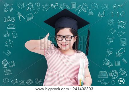 Cute Girl  Wear Bachelor Cap And Thumb Up On Green Chalkboard