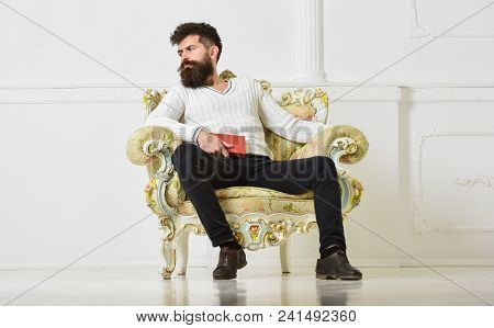 Connoisseur Of Literature Concept. Macho Spends Leisure With Book. Man With Beard And Mustache Sits