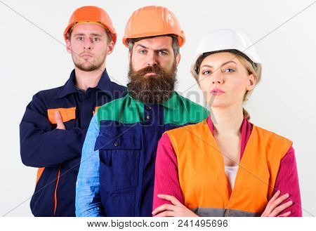Team Of Architects, Builders With Serious Faces, Isolated White Background. Woman And Men In Hard Ha