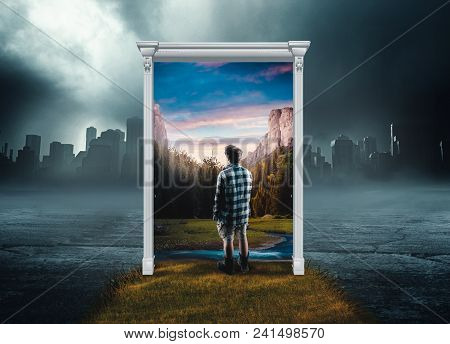 Man At Entrace Of  A Door Leading To A Mountain Resort, In A Background Of Dark And Cold City. The C