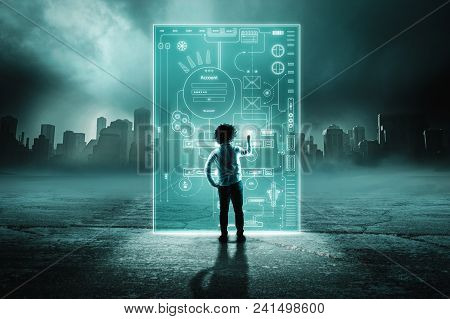 Man Using Digital Hologram Screen In A City Background.