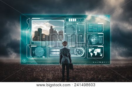 Developer Watching Informational Data On A Hologram Screen In A Field .