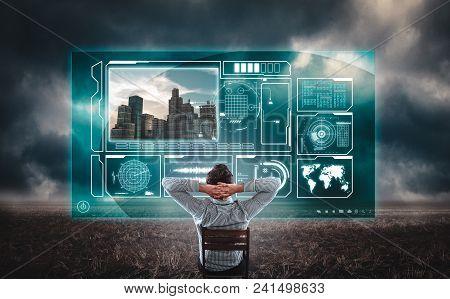 Developer Watching Informational Data On A Hologram Screen In A Field . Man Developing A Settlement.