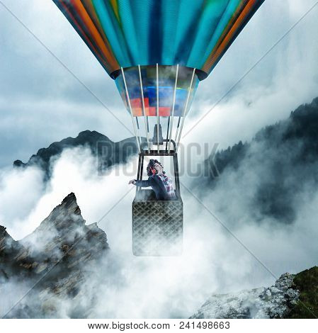 Young Woman Enjoying Her Flight In A Hot Air Balloon While Listening To Music. Flying In A Hot Air B