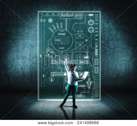 Business Woman Using Laptop In Front Of Digital Layout .
