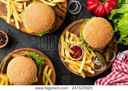 Tasty Burgers, Cheeseburgers, French Fries, Salad And Red Plaid Kitchen Textile, Table Top View. Thr