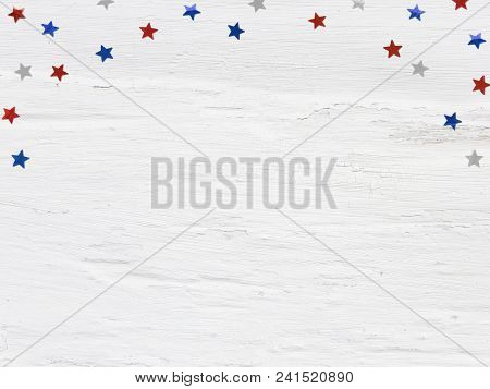 Glittering Confetti Stars On Old Grunge Wooden Background. 4th July, Independence Day, Card, Invitat