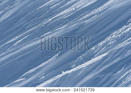 Landscape Format View Of Ridges Forming Oblique Lines In Wind Packed Snow