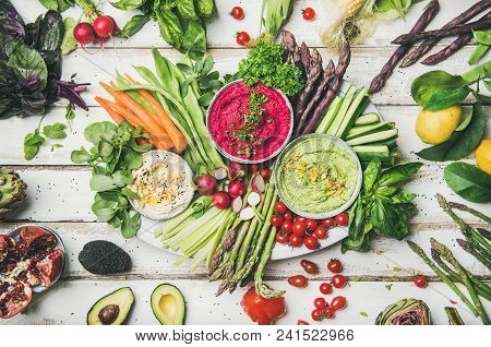 Healthy Raw Summer Vegan Plate. Flat-lay Of Chickpea, Beetroot, Spinach Hummus Dips With Colorful Ve