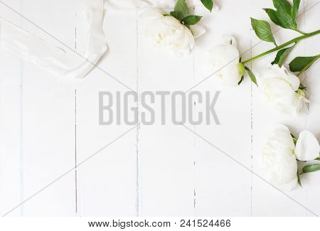 Styled Stock Photo. Feminine Wedding Table Composition With White Peonies Flowers And Silk Ribbon On