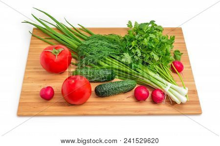 Bundle Of Washed And Peeled Green Onion Tied Together, Bunches Of Dill And Parsley, Tomatoes, Cucumb