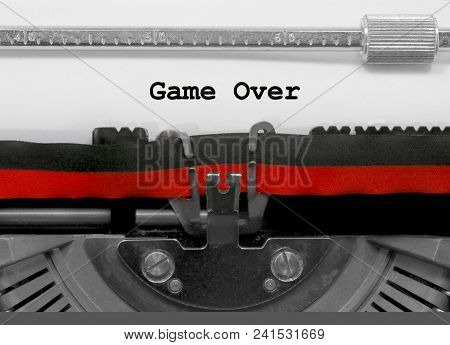 Game Over Text Written By An Old Typewriter On White Sheet