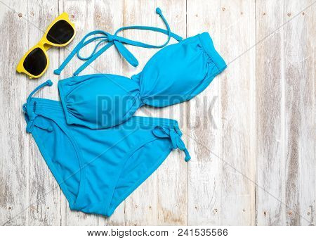 Flat Lay Of Summer Items With Colorful Bikini And Accessories On White Wooden Background, Summer Con