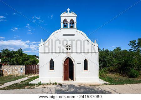 Generic Small Old Church On Silba Island In Croatia. Small White Church With Bells, Doors And Window