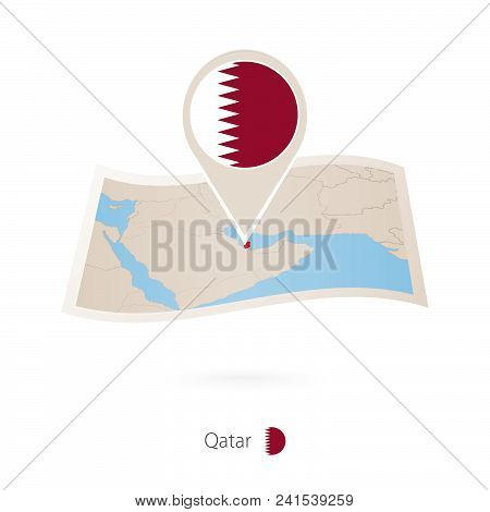 Folded Paper Map Of Qatar With Flag Pin Of Qatar. Vector Illustration